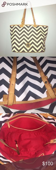 "Dooney & Bourke black and white chevron purse Dooney & Bourke black and white chevron purse with red interior. 12"" tall, 18"" across at top, and 6.5"" deep. Some wear and tear on inside and bottom, but not bad. Second picture shows true color and missing back of button. Strap sags a little because of the missing button (4th picture). Dooney & Bourke Bags Totes"