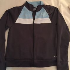 Champion Track Jacket Champion Track Jacket Dark Gray with Tarheel Blue and White Accent at Top. Full zip track jacket with pockets on either side. Never worn. Champion Jackets & Coats