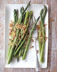 Ingredients  1 bunch asparagus, trimmed (about 1 pound)  1 tablespoon extra-virgin olive oil  Coarse salt and ground black pepper  1 tablespoon unsalted butter  1/2 cup coarse breadcrumbs (from 2 slices whole-wheat bread pulsed in a food processor)  Grated zest of 1 lemon  Directions  Preheat oven to 425 degrees.