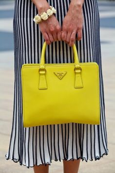 Prada.  Tend to shy away from shades bordering on the neon, but this is absolutely perfect with the black-and-white striped skirt...