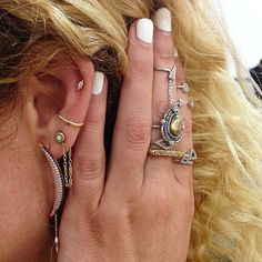 white nails. boho rings. gold. boho/chain earrings. midi rings