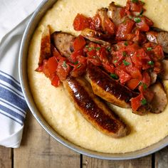 Creamy, cheesy grits capture the juices from the fresh tomatoes, making a perfect foil for the sausage links. Chicken sausage also works well in this . Tomato Sauce Recipe, Sauce Recipes, Wine Recipes, How To Cook Grits, How To Cook Polenta, Spinach And Cheese, Cheddar Cheese, Brunch Recipes, Breakfast Recipes
