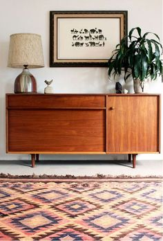 Pair our kilim rug with mid century console on our back wall.