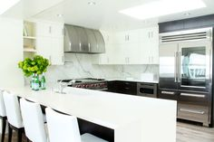 not fav kitchen, but like the idea of using white counter (quartz) + marble backsplash