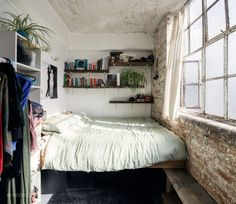 small bedroom solution. love the stone wall.