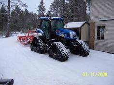 New Holland Tractor on track-conversion - used as a snow groomer
