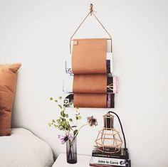 So why not style your magazines with this gorgeous magazinerack. Super soft leather - available in cognac & black. New Nordic Design at eniito.com  #eniito #caiaofsweden #newnordic #scandinavian #scandinavianstyle #racks #homeinterior #leathercraft #cognacleather #magazinerack