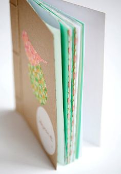 DIY book binding. What a great idea to use as party favours just add graphics, glitter, &/or other embellishments to covers to suit your party theme. Fill with blank &/or lined paper, colouring-in pages. Give with pencils, small pens or small packet pencils, stickers.  #partyfavours #notebook