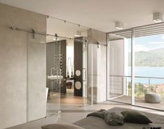 Frameless glass slider that disappears but makes a statement