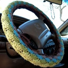 Steering Wheel Cozy pattern by Hook Candy, because you must crochet everything.