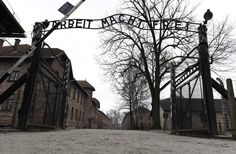 Ghosts of Auschwitz - © REUTERS/Pawel Ulatowski  - The sign Arbeit macht frei (Work makes you free) is pictured at the main gate of the former German Nazi concentration and extermination camp Auschwitz in Oswiecim January 19, 2015.