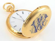 Swiss 18 karat yellow gold pocket watch in a very early Patek Philippe hunter case with engine turned engravings and blue enamel monogram, circa 1860. Retailed by Rodonet & CIE of Paris, signed on cuvette by Patek Philippe. 38mm. Restored with a one year warranty.
