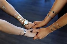 The Modern Bracelet Stack -- mix real jewelry and metallic tattoo jewelry