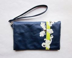 She makes the best designs, all hand made...Lapis Leather & Lace Clutch w/ Metal Studs and Neon Accents on Etsy, $124.00