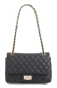 This classic quilted handbag with a link chain is totally chic and elegant.