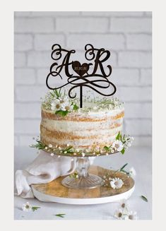 Bride and groom's initials with date heart in the center of this cake topper.