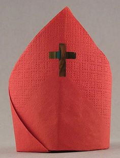 How to fold cloth or paper napkins to make a red miter napkin for Saint Nicholas Day table Dec. 6