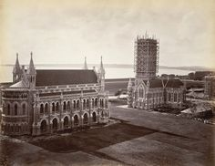 1 Bombay Town Hall Photo with Bombay Green Ground as seen from top of St. Thomas Cathedral, sailing ships in harbour in the background — at Bombay. Gothic Revival Architecture, Colonial Architecture, Bombay Image, Bombay To Mumbai, St Georges Hospital, University Of Mumbai, Mumbai City, History Of India, Times Of India