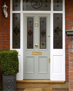 Victorian front door with stained glass a solid wood victorian door in heri Victorian Front Doors, Grey Front Doors, Front Door Porch, Exterior Front Doors, Painted Front Doors, House Front Door, Front Door Colors, Glass Front Door, Entrance Doors