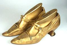 An extraordinary pair of antique shoes (circa 1910). Beautifully crafted from soft, fine gold leather, the fronts are decorated with gold glass beads.