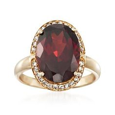 Heightened by .21 ct. t.w. diamonds, the smoldering intensity of this ring's 8.25 carat oval garnet will not go unnoticed!