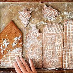 This snowy gingerbread city makes a stunning holiday centerpiece. We're sharing one of our favorite gingerbread house ideas including a free printable template. It's an easy Christmas decoration the kids can help make. You'll want to live in it. Gingerbread Village, Christmas Gingerbread House, Noel Christmas, Simple Christmas, Christmas Treats, Christmas Baking, Winter Christmas, Gingerbread Cookies, Christmas Cookies