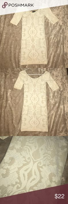 bebe white detailed bodycon dress Never worn white Bebe bodycon dress with pattern. Size M/L. Very flattering and hugs curves well. bebe Dresses Long Sleeve
