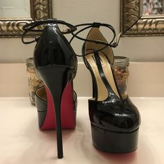 Signature by Shoedazzle Reina Pump Pink Bottom T-strap pump.   Double ankle strap.  Faux patent.  Six inch heel with two inch platform.   Some very minor damage on right toe - unnoticeable from a foot away.   Otherwise virtually flawless - never worn out. Shoe Dazzle Shoes Heels