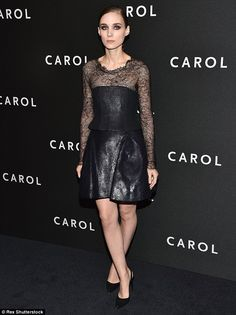 Quite the contrast: Meanwhile Rooney Mara wore a black leather dress with lace neckline an...