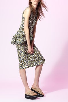 Marni's peplum top and pencil skirt look modern for day or night!