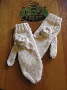 ivory knitted mittens with flower detail