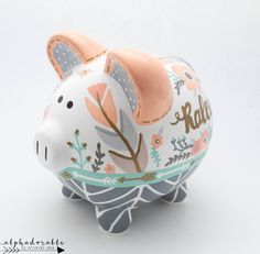 This boho chic and feather personalized piggy bank is created with porcelain ceramic and is completely hand painted using the highest quality acrylic paint. The art is forever protected by a glossy diamond finish glaze. Each piggy bank is hand painted esp Nursery Twins, Nursery Art, The Little Couple, Personalized Piggy Bank, Grey And Gold, Pottery Painting, Porcelain Ceramics, Baby Shower Gifts, Boho Chic