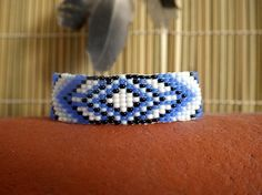 Hey, I found this really awesome Etsy listing at https://www.etsy.com/listing/275699514/blue-arrows-native-america-bead-bracelet