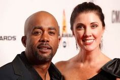 Darius Rucker and wife. Darius is the former frontman of the mainstream pop/rock band Hootie & the Blowfish and a current country star. http://everythingiric.blogspot.com/2011/05/have-you-met-country-music-star-darius.html