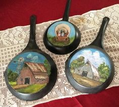 Painting on old Frying pans. Painted by Little Rock artist Sugar Warner.