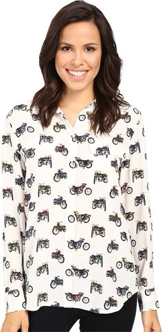 EQUIPMENT Women's Slim Signature Blouse Nature White/Multi Blouse. Feel your best in this EQUIPMENT® staple. Luxuriously soft silk crepe constructs this versatile blouse. Slim silhouette is perfect for work or play. Fold collar and long sleeves with button cuffs. Full button-front closure. Dual flap pockets at chest. Curved shirttail hemline. 100% silk. Dry clean only. Imported. Measurements: Length: 29 in Product measurements were taken using size SM. Please note that measurements may…