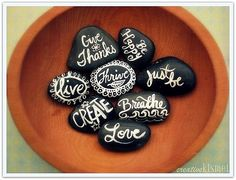 painted rocks with inspired words by amelia