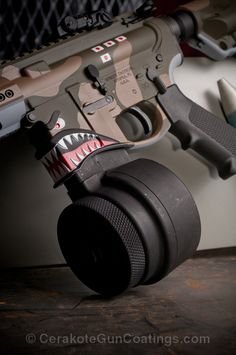 Cerakote Coatings: H-240 Mil Spec O.D. Green with H-267 MagPul Flat Dark Earth and H-167 USMC Red
