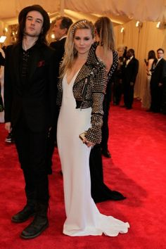Tom Sturridge in Burberry Prorsum; Sienna Miller in Burberry Prorsum, Genevieve Jones ear cuff, and Eddie Borgo tiara