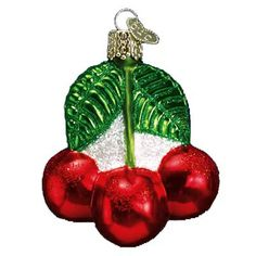 "Cherries Christmas Ornament 28050 Merck Family's Old World Christmas Luscious red cherries with green leaves. Ornament measures approximately 2 3/4"" and is made of mouth blown,"