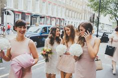 Image by Dale Weeks Photography - A modern London wedding with a bride in a short lace dress and pink bridesmaids by Dale Weeks Photography