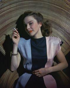 40s glam portrait pink blue black striped color block dress color photo print ad vintage fashion March 1945 by dovima_is_devine_II, via Flickr