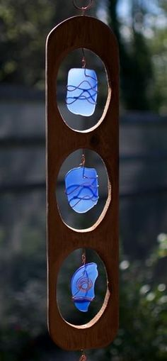 A beautiful cedar, glass, and copper wind chime- inspired by nature. This wind chime measures about 55 inches long from the top of the copper hanger to the bottom of the hammered copper windsail. The