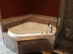 Wyoming Renovation: Corner Tub with TruStone Surround & Accent Border