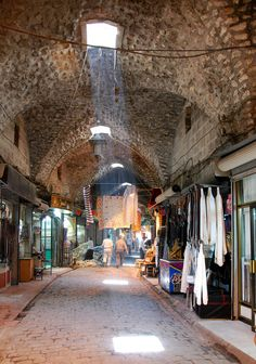 The Syrian sun pierces through a window in the old brick souq in Medieval Aleppo. Aleppo City, Old Bricks, Old Doors, Baghdad, Damascus, Medieval, Tourism, Scenery, Old Things