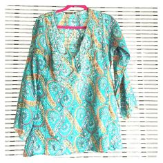 100% silk bohemian tunic This is a beautifully detailed silk tunic. Never worn. 3/4 sleeves. Size s/m. Subtle luxury Tops Tunics