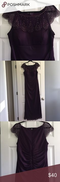 Purple gown Floor length purple dress with beaded sheer cap sleeves. Zipper closure. Padded bra. Excellent condition, worn once to a wedding. 100% Polyester Dresses