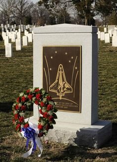 Remembering those lost... A wreath placed by NASA Deputy Administrator Shana Dale and other NASA senior management is seen in front of the space shuttle Columbia memorial on Jan. 31, 2008, at Arlington National Cemetery in Virginia. The wreath-laying ceremony was part of NASA's Day of Remembrance. Wreaths were laid in the memory of those men and women who lost their lives in the course of space exploration, including the astronaut crews of Columbia, Challenger and Apollo 1.