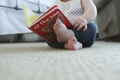 I love how the baby is doing what she loves, and you capture one of her favorite books in the photo, so you don't forget what she's into at what age!     jenjohnson.typepad.com