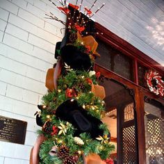 Cowboy hat Christmas tree at the Stetson Mansion love the idea of putting a FEW mini hats in the tree.